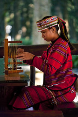 Weaving (..ChEn..) Tags: people girl woman taiwan culture weave weaver working concentration focus traditional performing performer teaching demonstration clothing 紡織 九族 red