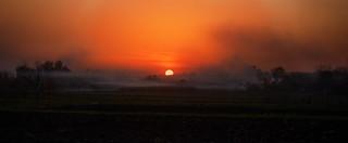 a village in the evening haze