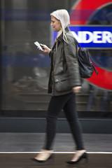 Telecom (Sean Hartwell Photography) Tags: london kingscross trainstation londonunderground woman girl telephone telecom street city movement week422017 52weeksthe2017edition weekstartingsundayoctober152017