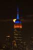 Harvest Moon ([ raymond ]) Tags: empirestatebuilding fullmoon harvestmoon manhattan newyork nyc skyline img9436 awesome vertical iconic orange