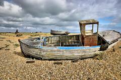 Old Boats (Croydon Clicker) Tags: boats shingle stones wrecks decay clouds sky 1000v40f