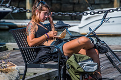 2017 - Boston - Benched (Ted's photos - Returns Late November) Tags: 2017 boston cropped massachusetts nikon nikond750 nikonfx tedmcgrath tedsphotos usa vignetting female girl tattoo seating seated sitting seat bench bicycle chain chainlink backpack sunglasses bokeh