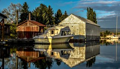 In the river's looking glass (Christie : Colour & Light Collection) Tags: reflections reflection river alouetteriver pittmeadows bc canada romantic serene peaceful nikon boats boat boathouse boatshed outdoors exploring calm calming
