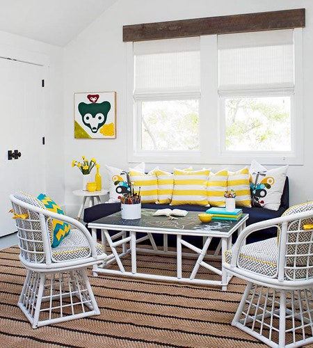 Living Room Decor : Relaxed rattan-style furniture adds to the beachy vibe of this cheery living roo...