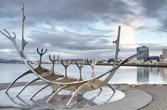 The longboat (Rob McC) Tags: sculpture monument longboat symbolic reykjavik iceland waterfront reflection goldenhour twilight landscape cityscape