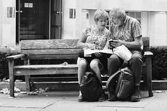 Day 289. Phone v map. (Rob Emes) Tags: urban city london street phone tech map couple bench bw black mono g7xii canon 3652017 365 oct2017
