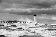 To the Wire (Aaron Springer) Tags: michigan northernmichigan lakemichigan thegreatlakes manisteenorthpierheadlight octobergale breakingwaves weather storm lighthouse waves water blackandwhite monochrome outdoor nature seascape
