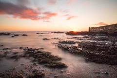 Sunrise over harbour (M McM) Tags: sunrise rocks sea seashore coast coastline wall stone harbour clouds red pink landscape sunburst auchmithie angus scotland canoneos760d longexposure