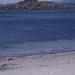 Porth Mellon beach small sand replica of offshore rock