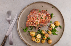 Baked marinated pork and potatoes. (annick vanderschelden) Tags: raw pork cutlet marinating ingredients grounded blackpepper seasalt choppedgarlic sugarcanesugar soysauce lemonjuice sunfloweroil redwinevinegar sambal worcestershiresauce baked smallpotatoes herbesdeprovence whitekitchenboard pointofview meat marinade marination pig salt chopped sugarcane soy sauce vinegar potato peelingknife lighteffect knife belgium