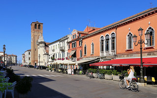 Biking on the mainstreet on Chioggia island