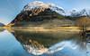 Scottish sunrise (evorichie101) Tags: glencoe snowy sun sunrise nikon lake reflection