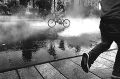 Nice, Encounters (Coquine!) Tags: christianleyk nice nizza france blackwhite schwarzweiss fontain brunnen encounter treffen children kids kinder reflection spiegelung water wasser boy girl bicycle fahrrad junge mädchen artinbw