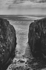 The Gap (grobigrobsen) Tags: castlemartin pembrokeshire wales cymru greatbritain unitedkingdom landscape coast uk bw blackandwhite monochrome travel drama rocks ocean sea