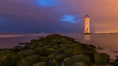 When you miss the sunset and light pollution takes over! (G-WWBB) Tags: newbrightonlighthouse perchrock perchrocklighthouse lighthouse lightpollution rocks sea mist blue orange red green tide clouds