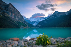 Sunset at Lake Louise (Margarita Genkova) Tags: lakelouise alberta canada lake rockymountains reflections sunset mountains glacier clouds sky colors landscapenature scenery snowcapped fall calm water serene