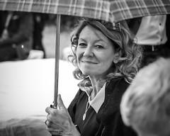 N. with an umbrella on a rainy day, near Bocholt, Germany ([ PsycBob ]) Tags: woman frau regenschirm umbrella regen rain bw sw black white schwarz weis smile lachen