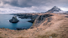 Arnarstapi - Iceland - Travel photography (Giuseppe Milo (www.pixael.com)) Tags: view water panorama hill pano snow longexposure gatklettur west hills beautiful travel iceland clouds rocks sky seascape arnarstapi sea geotagged mountain is onsale
