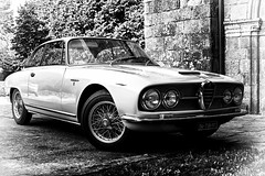 The Alfa Romeo 2600 sprint ... (Missy Jussy) Tags: saintyrieixlaperche village france building church reflections alfaromeo car classiccar transport holiday trip travel southwestfrance mono monochrome blackwhite blackandwhite bw canon canon5dmarkll 50mm ef50mmf18ll canon50mm fantastic50mm italian carmanufacturer
