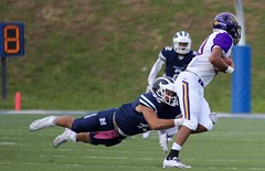 Hit Hard and Low (stephencharlesjames) Tags: college sport football ball sports ncaa tackle action middlebury vermont