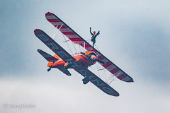 Wing Walker (JKmedia) Tags: wing walker women boultonphotography plymouth 2017 armedforcesday flying aircraft biplane areobatics smoke display breitling orange grey day daring