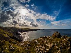 Rough Coast (davYd&s4rah) Tags: cornwall england coast ocean sea jurassiccoast sky clouds fisheye olympus epl7