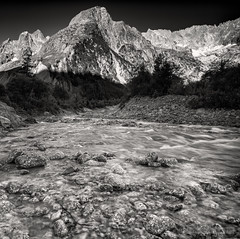 Glacier Melt (John Fÿn Photography) Tags: 24mmpce 24mmtiltshiftlens bw blackandwhite cold d810 europe gray grey mono monochrome nikon nikonfx outdoor river stone switzerland water alps bitter bleak brisk chilled cool crag crisp elevation foothills frigid frosty frozen glacier hill icy intense landscape mountain mountainrange peak peaks perspectivecorrection polarised polariser polariserfilter polarized polarizer polarizerfilter range raw ridge riverbank rocks snowy stream tiltshift wintry orsières valais ch