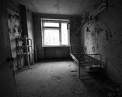 Side Ward (Explore 25/10/17 #99) (Sarah Marston) Tags: hospital sideward ward hospitalward pripyat pripyathospital bed lamp bottles chernobyl derelict sony alpha a77 october 2017 desolate creepy abandonedplaces abandonedbuildings ukraine