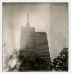 Gables Republic Tower (tobysx70) Tags: the impossible project tip polaroid slr680 frankenroid sx70 door rollers bw blackandwhite film for 600 type cameras instant impossaroid gables republic tower north ervay street dallas texas tx bank building spire skyscraper highrise office trees mint lens set yellow filter polacon2017 polacontwo polacon 092917 toby hancock photography