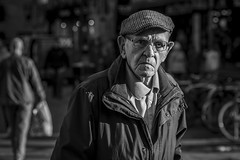 The Harsh Light of Day (Leanne Boulton) Tags: portrait people urban street candid portraiture streetphotography candidstreetphotography candidportrait streetportrait eyecontact candideyecontact streetlife old aged elderly man male face facial expression eyes look emotion feeling mood cap winter sunlight dour tone texture detail depthoffield bokeh naturallight outdoor light shade shadow shadows city scene human life living humanity society culture lifestyle canon canon5d 5dmkiii 70mm character ef2470mmf28liiusm black white blackwhite bw mono blackandwhite monochrome glasgow scotland uk
