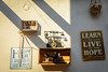 Cafe display, Monemvasia, Greece (robert_haken) Tags: collage street antique art sign cafe quotes quote slogan wall life tags dreams live learn