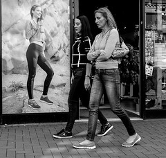 Got the shoes (phil anker) Tags: people street mono fujix70 juxtaposition