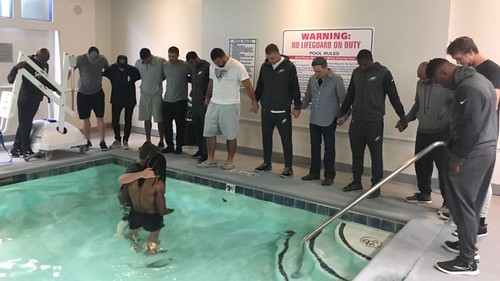 Philadelphia Eagles' Marcus Johnson baptized in hotel pool with teammates by his side