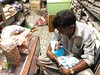 Shopkeeper Papa's 12-Day-Old Daughter's First Day in the Shop (Mayank Austen Soofi) Tags: baby shopkeeper papa's 12dayold daughter's first day shop