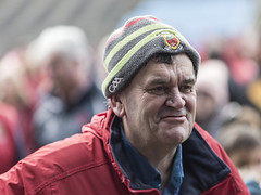 Portrait of a happy man (Frank Fullard) Tags: frankfullard fullard candid street portrait red happy smile smiling content mayo castlebar face irish ireland colour color cap crest gaa football gaelic gaelicfootball peil castlebarmitchels mitchels champion winner