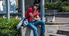 2017 - Charlottetown - Chat Time (Ted's photos - For Me & You) Tags: canada charlottetown cropped nikon nikond750 nikonfx pei tedmcgrath tedsphotos vignetting cellphone 2017 male man boy handsome handsomeboy sunglasses denim denimjeans sitting seated legs red redrule