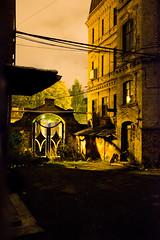 The gate of perception (MarxschisM) Tags: riga latvia old building abandoned factory gate shadows street lights fuji xt1 samyang21mm