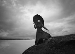The Edge (Maren Klemp) Tags: fineartphotography fineartphotographer blackandwhite monochrome darkart darkartphotography umbrella woman portrait selfportrait conceptual surreal dreamy painterly ethereal lake water ocean clouds outdoors nature naturallight
