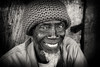 Ghana, tailor in Winneba (Dietmar Temps) Tags: beard culture ethnic ethnie ethnology face naturallight oldman outdoor people portrait streetphotography tradition traditional 50mm blackandwhite africa afrika afrique fishingvillage streetlife fun smile ghana goldcoast accra winneba tailor hat