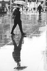 Here comes the rain again... (Sean Hartwell Photography) Tags: london kingscross railway station rain umbrella wet weather man street urban reflection walking