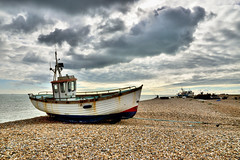 Beached Boat (Croydon Clicker) Tags: boat sea sky beach clouds fishing fisherman rods shingle pebbles stones 1500v60f