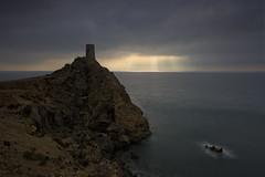 The sky broke (explore) (Rafael Díez) Tags: españa andalucia almeria mojacar amanecer sunrise sun sol nubes mar paisaje verano torre elpirulico rocas filtro rafaeldíez