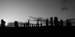 Standing Stones (rainer_schulze) Tags: scotland travel bw black standing stones callanish isle island lewis hebride old ancient prehistoric megalithic sunset flare