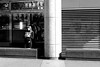 In front of the open shutter (pascalcolin1) Tags: paris femme woman stores shutter lumière light photoderue streetview urbanarte noiretblanc blackandwhite photopascalcolin 50mm canon