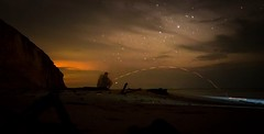 Watching the Sunset (SawardPhotography) Tags: night smoke cigarette trail light lighttrail flick reflection slow relax beach miri sarawak malaysia stars nightime nighttime sunset