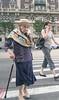 Crossing Broadway (UrbanphotoZ) Tags: women cane shawl hat old clutching bag smartphone crosswalk intersection apartmentbuilding upperwestside broadway manhattan newyorkcity newyork nyc ny