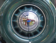 Wheel in the Sky (skipmoore) Tags: chevrolet tire wheel hubcap reflection