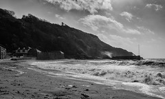Polkerris meets Ophelia. (Go placidly amidst the noise and haste...) Tags: polkerris ophelia hurricane mono blackandwhite blackwhite silverefex contrejour waves storm pier breakwater cornwall southwest westcountry beach clouds