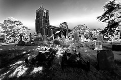 Haunted graveyard (David Feuerhelm) Tags: blackandwhite monochrome bw noiretblanc schwarzundweiss contrast silverefex solorisation infrared ir wideangle haunted atmosphere church building tower graves tombstones gravestones nikon d90 sigma1020mm