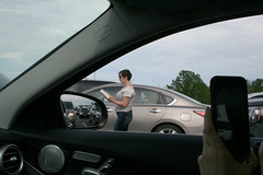 passing time while waiting to cross the border into Quebec (wmpe2000) Tags: 2017 trip canada quebec bordercrossing traffic slow womanreading